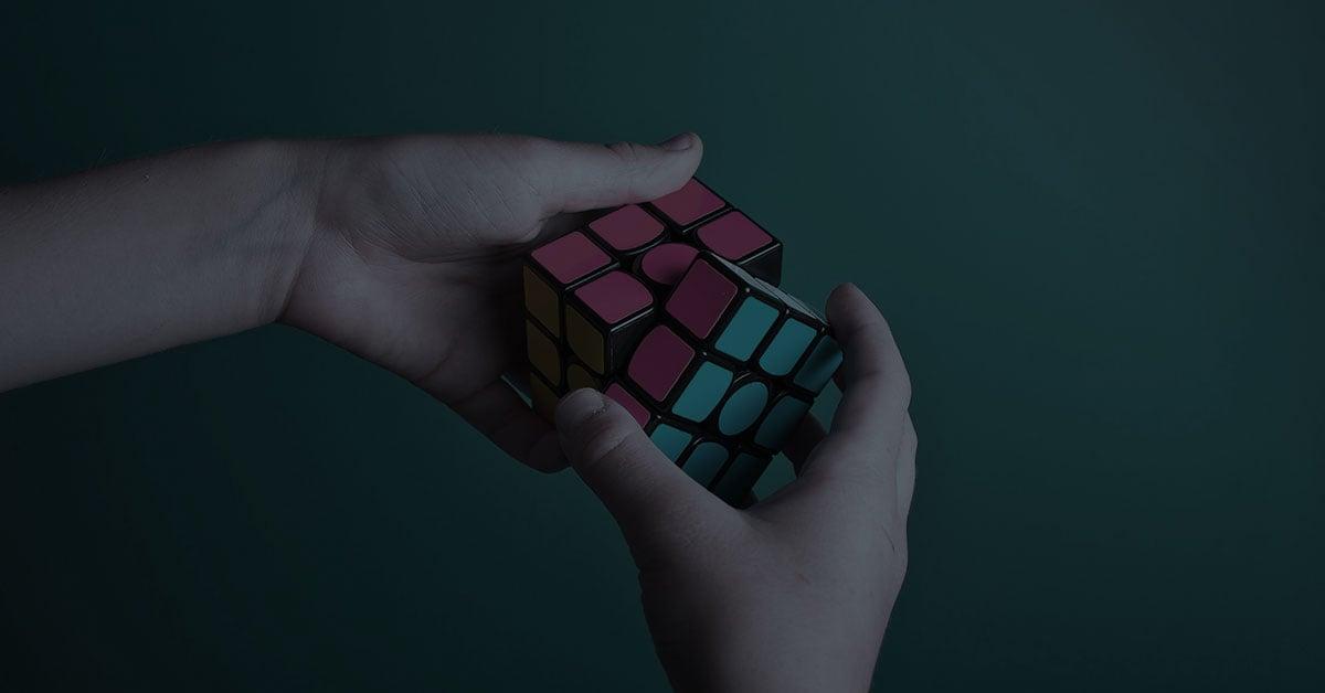 hands solving rubix cube